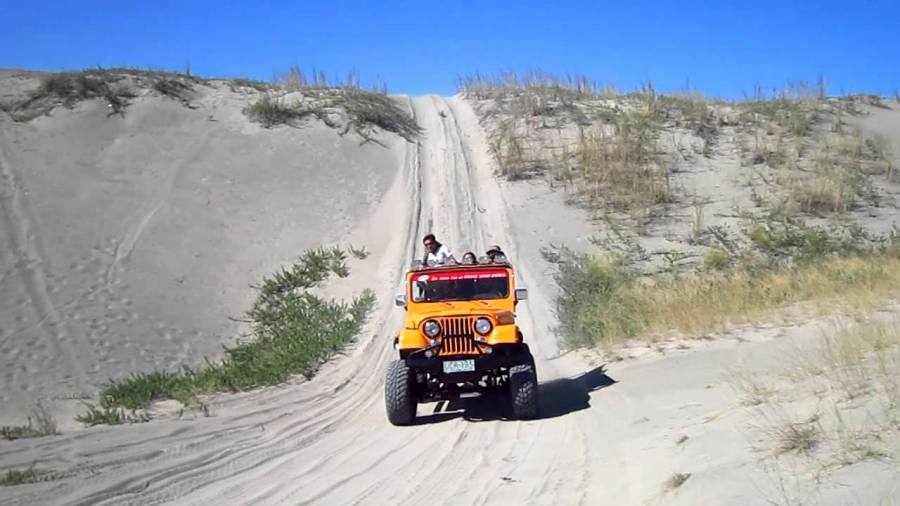 7 - Race to the finish line with a 4x4 ride Sandboarding
